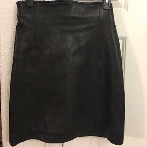 "Cache black Leather skirt approx: 14"" across waist"