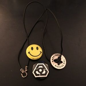 Happy face pin and butterfly necklace