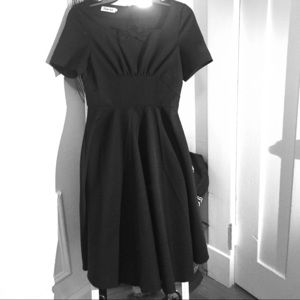 Black dress full skirt runs small