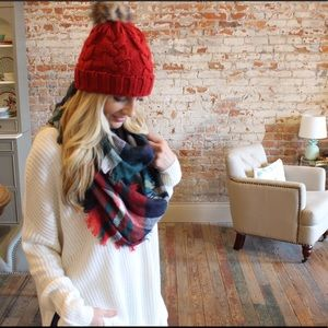 Red cable knit beanie with fax fur Pom Pom