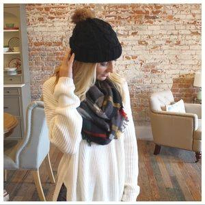 Black cable knit beanie with faux fur Pom Pom