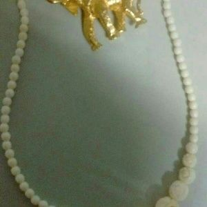 Ivory necklace  with elephant pin