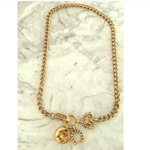 Gold Juicy Couture charm necklace