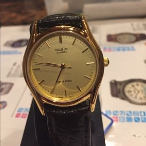 Casio UNISEx brown band GoldTone case medium size
