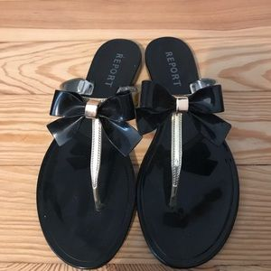 Black and gold bow flip flops