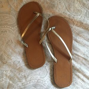 Brown and silver flip flops from GAP