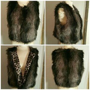 Jennifer Lopez Faux Fur vest. Size Large