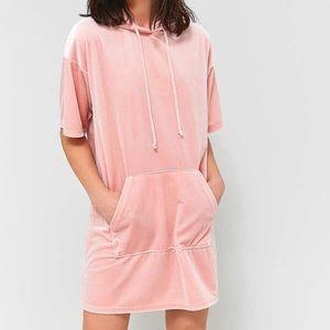 A velvet pink dress with a hood.