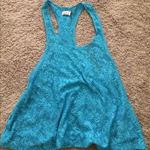 Never worn bathing suit tank top cover.