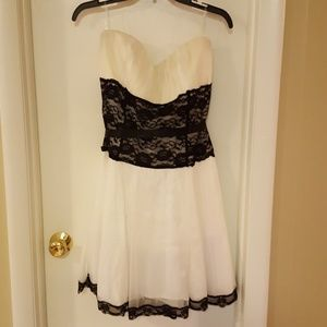 White dress with black lace waist and trim