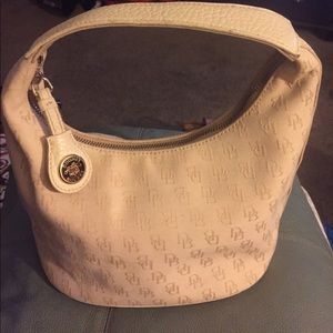 Dooney & bourke tan small bag.