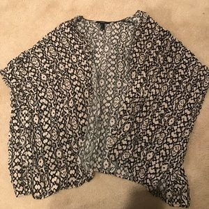 Black and tan patterned cardigan.