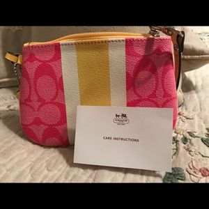 Coach pink and yellow wristlet