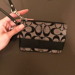 Black coat wristlet brand new