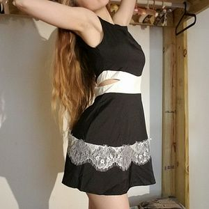 Black skater dress side cut outs white lace trim
