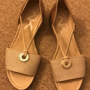Cute gold sandals. Too small for me.