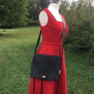 The SAK black leather Flap Front crossbody bag