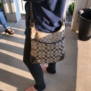 canvas coach cross body with outside front pocket