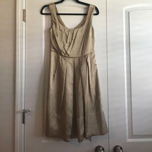 Never worn Gold Banana Republic dress. Size 2!