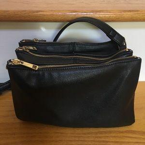 3 pocket black purse with cheetah print on inside