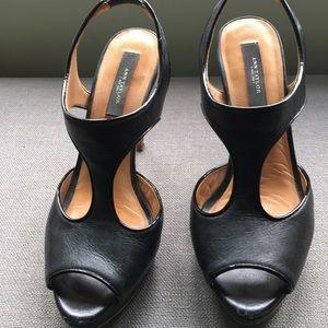 Black leather T strap heeled sandals