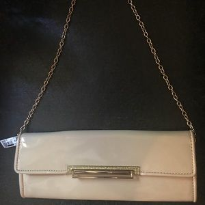 Aldo nude patent leather clutch with chain