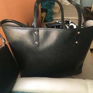 Black Coach tote bag with pouch and box