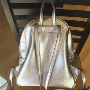 GUESS silver backpack. Multi pocket.