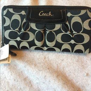 Coach signature zip around wallet. NWT