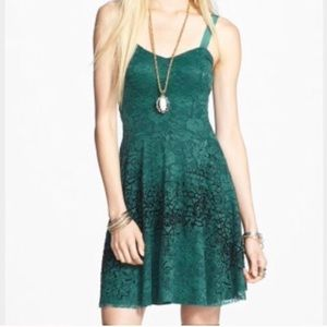Green and black lace fit and flare skater dress