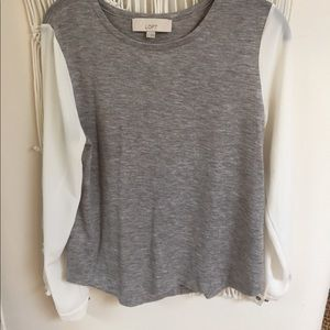 Grey and white blouse.