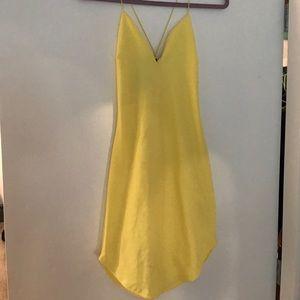 Yellow form fitting dress