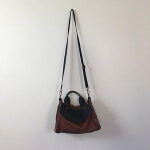 Brown and black cross body bag