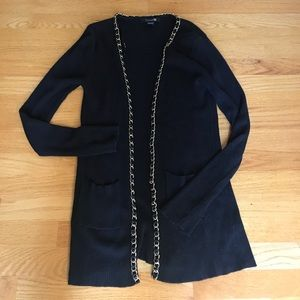 Black cardigan with gold chain detail