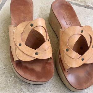 Natural leather platform sandals.