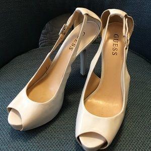 White sling back platform heel.