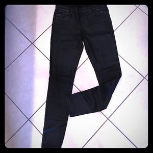 Black lacquered J brand skinny jeans