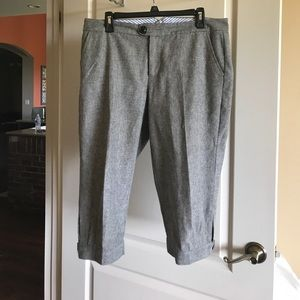 Cropped pants that gather and button at the knee