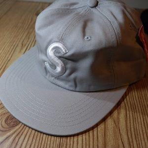 grey and white supreme hat