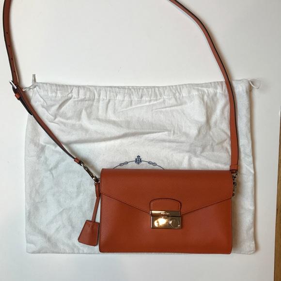 eb49111d741b ... best price prada saffiano mini sound bag in papaya f0fb2 02d00