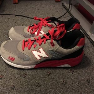 Gray & Red New Balance sneakers