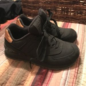 new balance sneakers - all black with gold heel