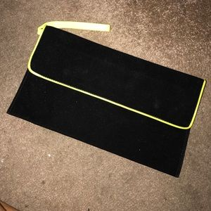 Black faux suede and neon leather clutch