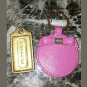 2 Coach key chain pink bronze never used