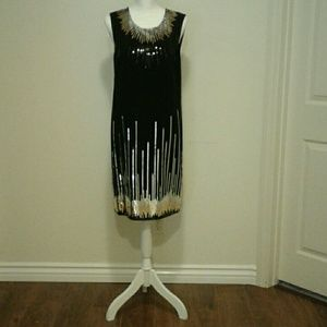 Black gold and silver sequence dress