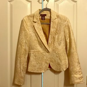 Cream blazer with gold stuffed floral pattern.