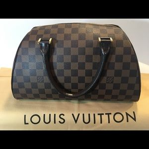 Authentic Louis Vuitton Ribera handbag