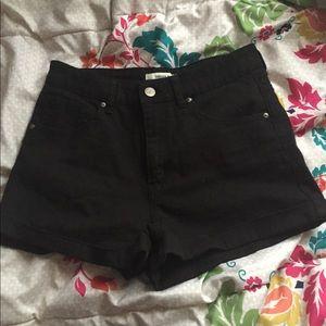 Black cuffed shorts.