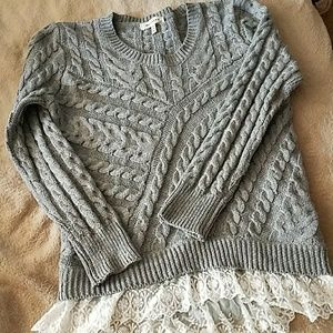 Gray knit sweater with bottom lacing