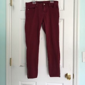 Red skinny jeans with ankle zippers